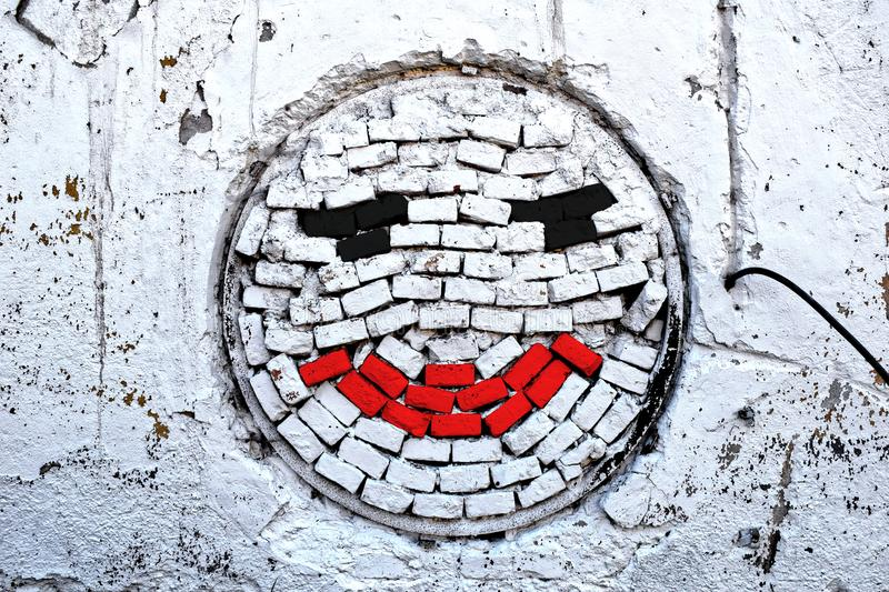 White brick wall with smile stock images