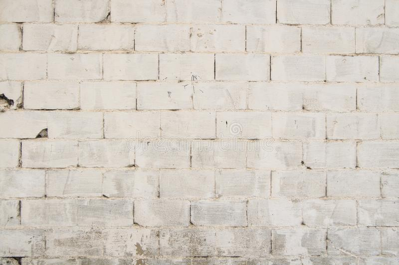 White Brick Wall Texture for Background and Design Art Work. Simple white grungy brick wall as seamless pattern texture background or as art design overlay stock image