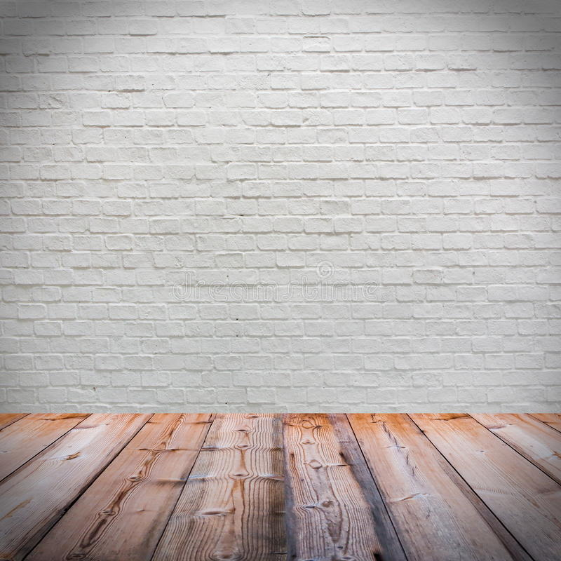 White brick wall with wooden floor royalty free stock image