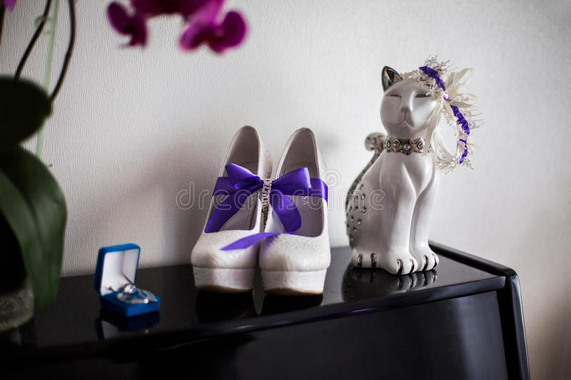 White bridal shoes,bride fees bride morning stock photo