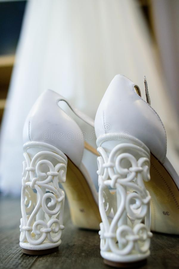 White bridal shoes royalty free stock photography