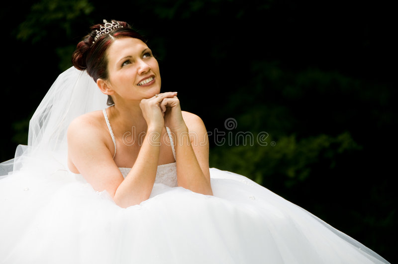 White Bride. At her wedding posing with veil stock images
