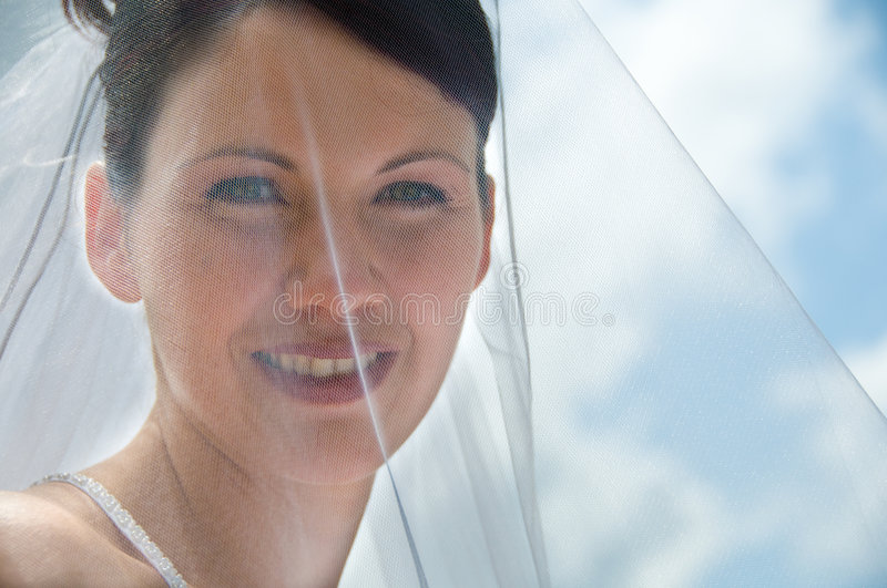 White Bride. At her wedding posing with veil stock photography