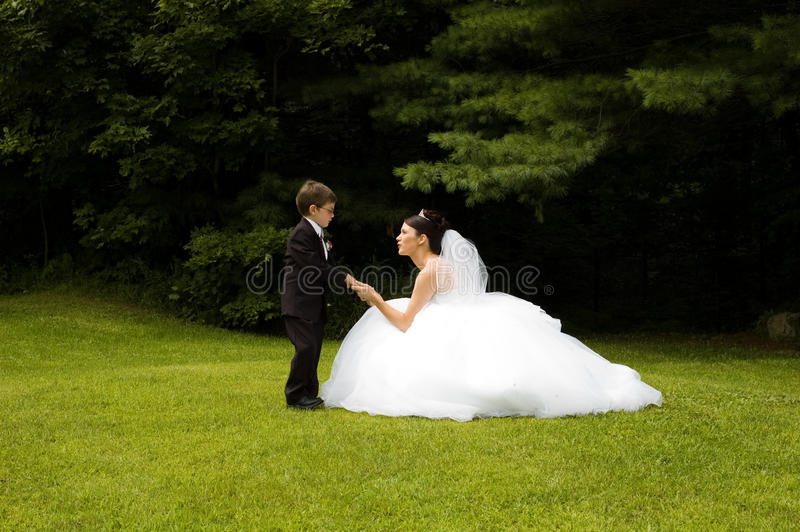 White Bride. At her wedding posing with veil royalty free stock images
