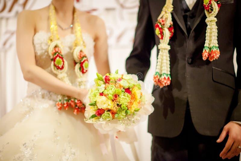 White bride dress holding fresh beautiful flower bouquet. Bride wear white bride dress holding fresh beautiful flower bouquet with blur background royalty free stock image