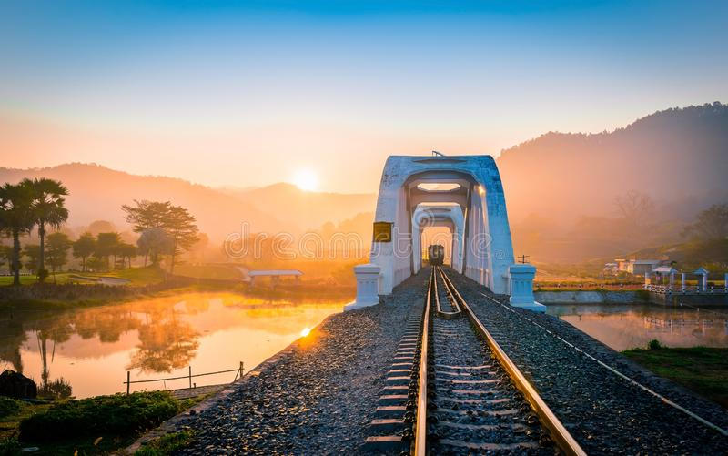 White Bridge Railwaytrain white bridge In the history of Mae Tha, Lamphun in the mist in the winter.Take a train from Lampang to royalty free stock images