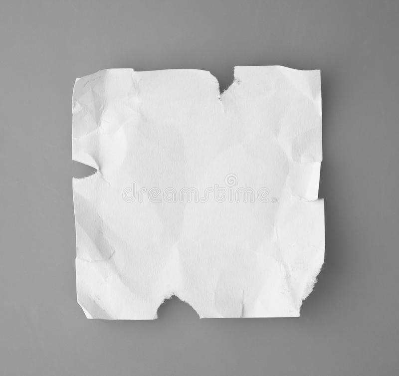 Download White Broken And Creased Paper Note  On A Gray Backgroun Stock Photo - Image: 30109174