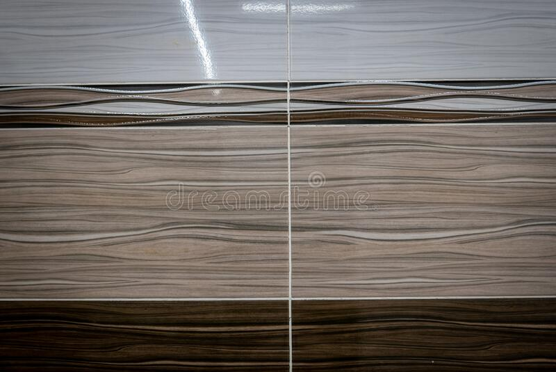 White and brown ceramic tiles on the wall background stock photos
