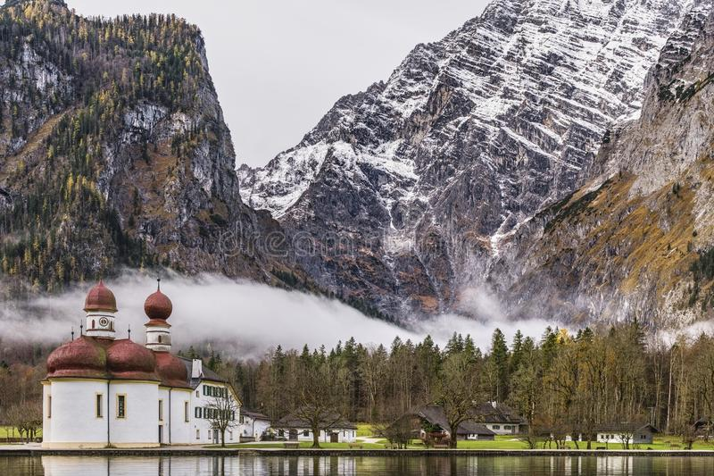 White and Brown Mosque Beside Body of Water Near Rocky Mountain stock photos