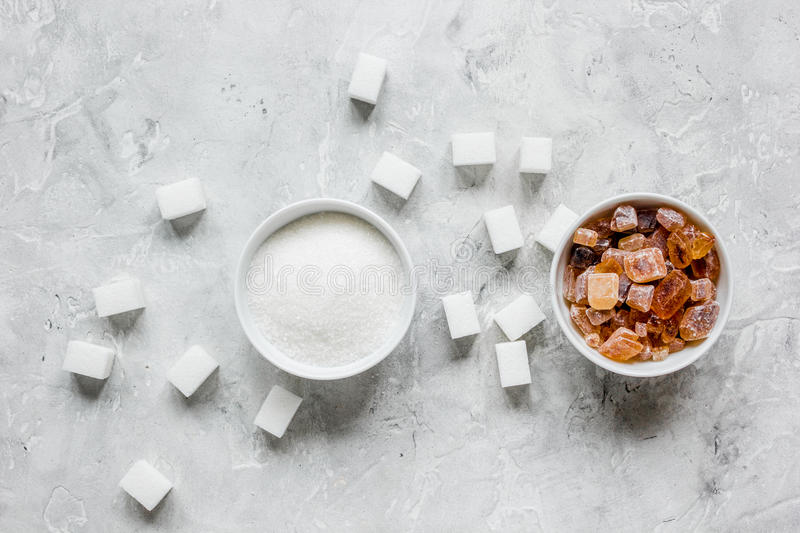 White and brown sugar for cooking sweets on kitchen stone table top view. White and brown sugar for cooking sweets on kitchen stone table background top view stock photo