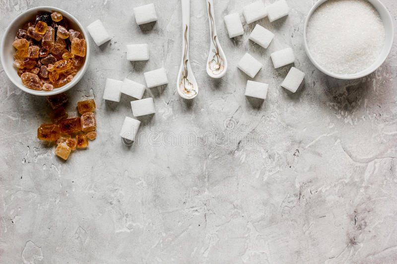 White and brown sugar for cooking sweets on kitchen stone table top view mock-up. White and brown sugar for cooking sweets on kitchen stone table background top royalty free stock photos