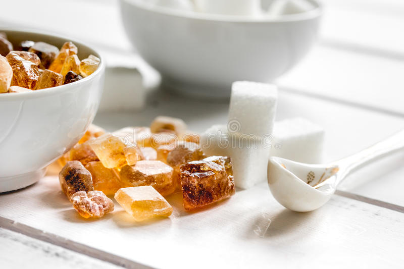 White and brown sugar for cooking sweets on kitchen white wooden table close up. White and brown sugar for cooking sweets on kitchen white wooden table royalty free stock image