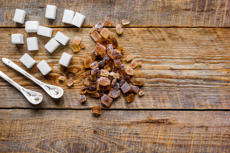 White and brown sugar for cooking sweets on kitchen wooden table top view mock-up. White and brown sugar for cooking sweets on kitchen wooden table background royalty free stock photography