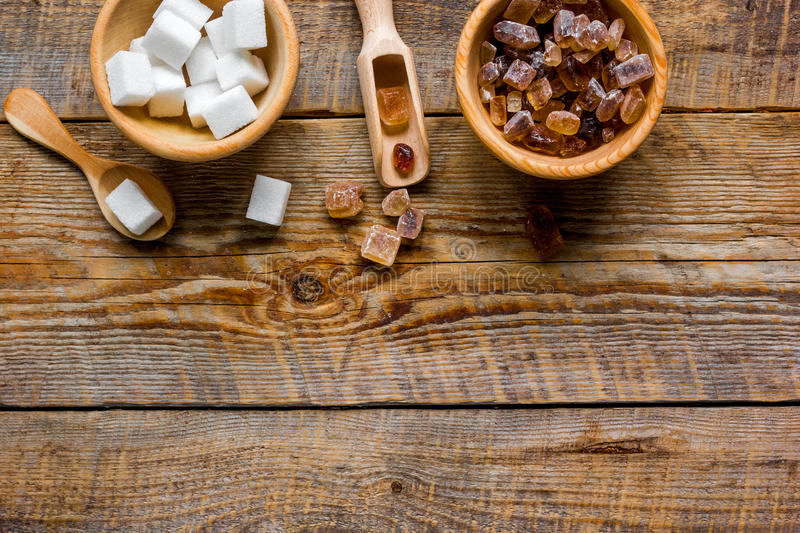 White and brown sugar for cooking sweets on kitchen wooden table top view mock-up. White and brown sugar for cooking sweets on kitchen wooden table background royalty free stock images