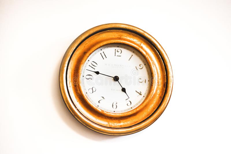 White and Brown Wall Clock Reading at 4:48 royalty free stock image