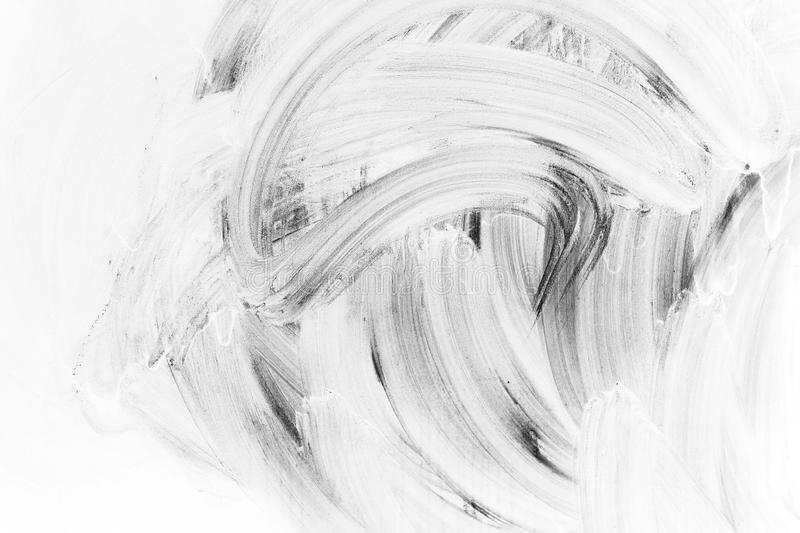 White brush strokes paint pattern. Abstract background photo texture, white brush strokes paint pattern over dark wall stock photography