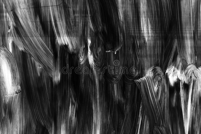 White brush strokes pattern over black wall stock images