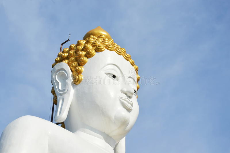 White Buddha image in Wat Phrathat Doi Kham ancient temple in Thailand stock image