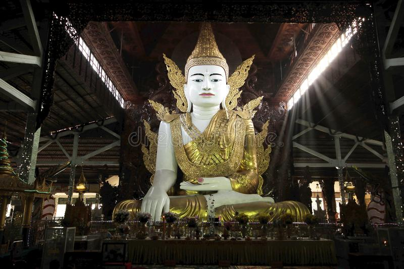 White Buddha in the temple, Myanmar. White Buddha on the large base worshiping the temple at Myanmar royalty free stock image