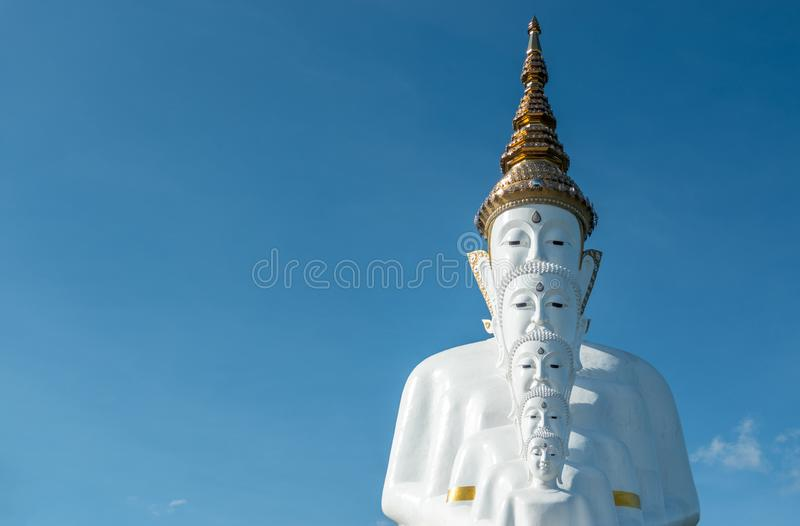 5 white buddha statue on blue sky background with copy space. Wat Phra Thart Pha Son Kaew temple stock photography