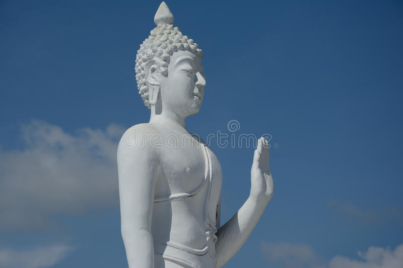 White buddha statue lift hand. royalty free stock images