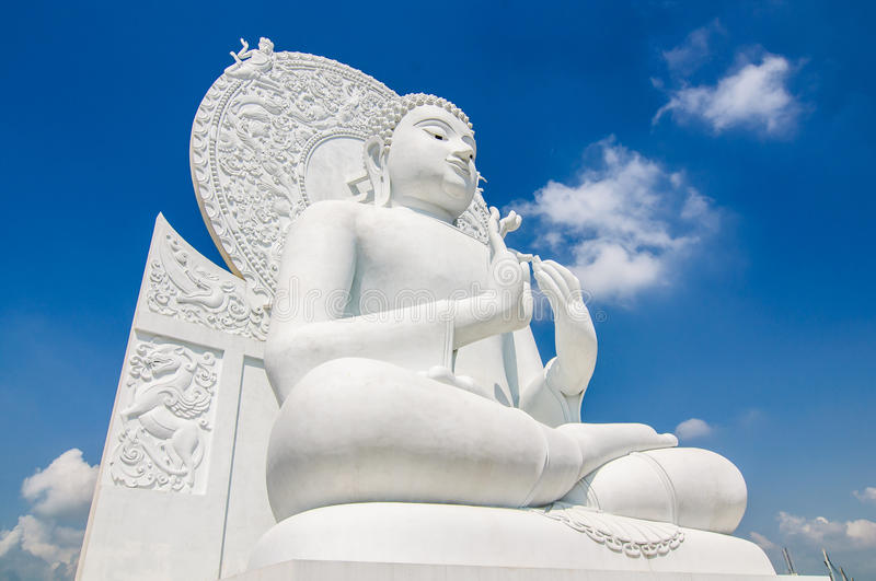 White buddha status on blue sky background. In thailand royalty free stock images