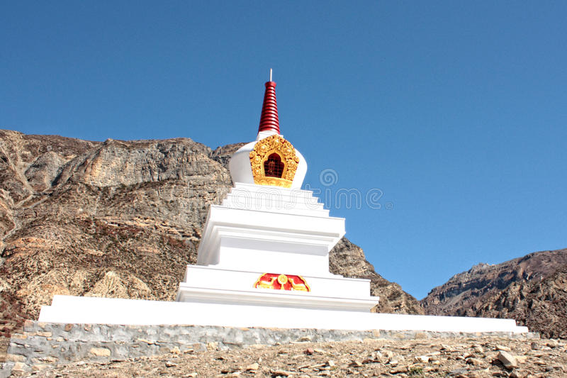 White buddhist stupa in the mountains of Nepal royalty free stock image