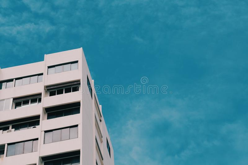 White building and blue sky in summer. Architecture, landscape, travel, city, view, sunny, tower, tourism, nature, day, modern, landmark, beautiful, cityscape stock photo