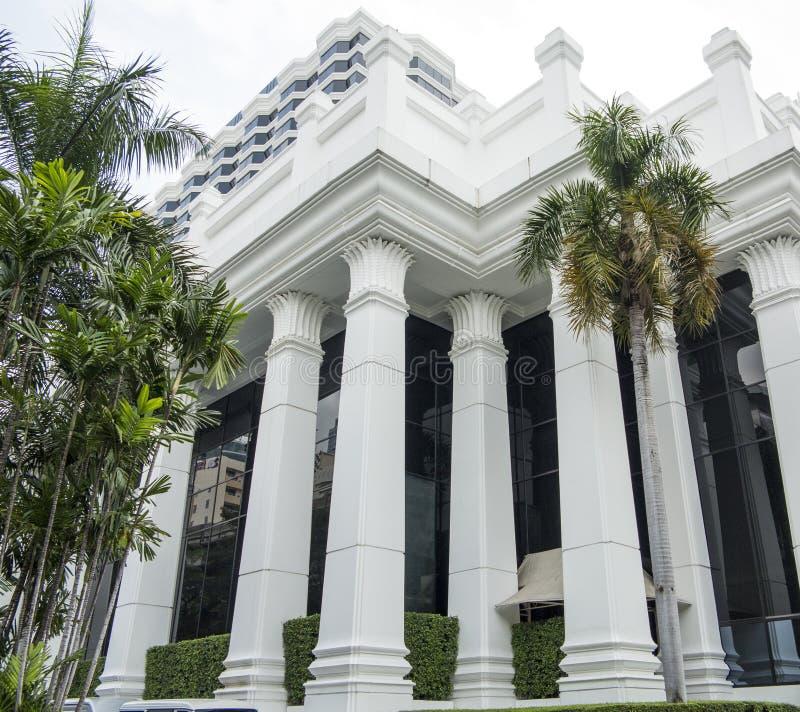 White building facade. White modern building facade with tall columns royalty free stock photography