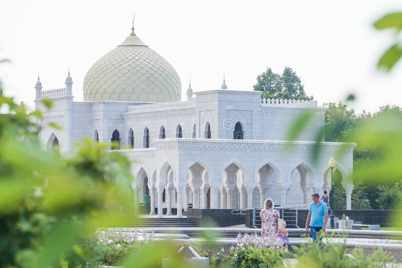 The white building of the mosque with beautiful arches and a large dome. stock photo