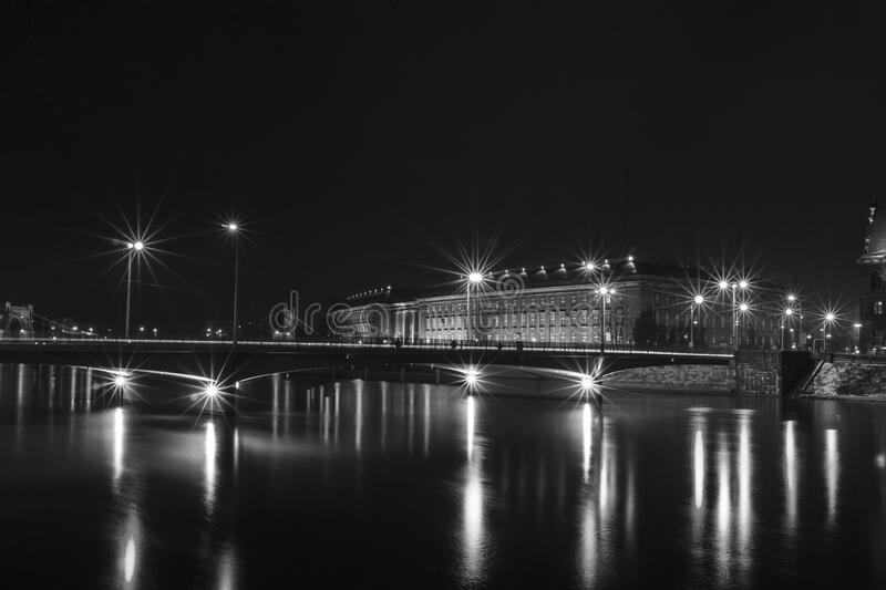 White Building Near Bridge With Lights stock photography