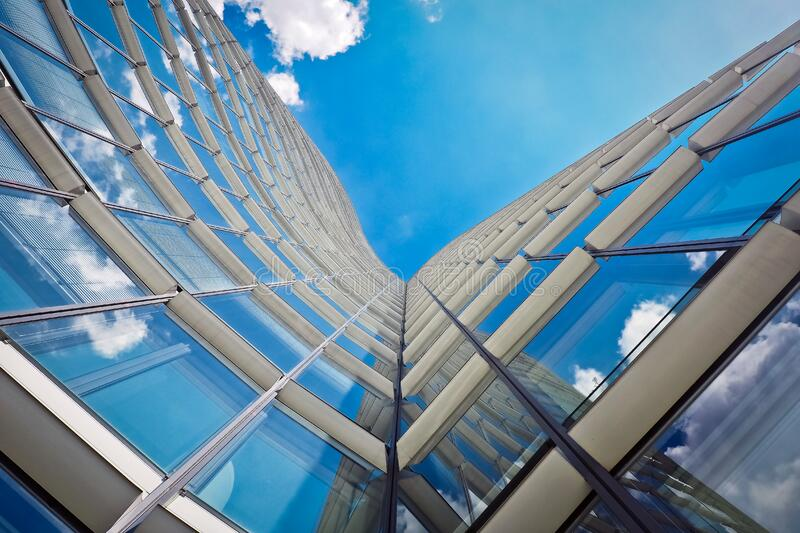 White Building Under Clear Blue Sky in Worms Eye View Photography stock images