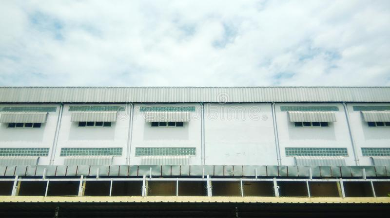 The white building. White building with cloud background royalty free stock photo