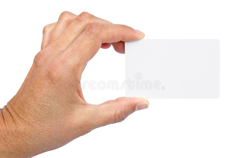 White business card in a womans hand. Womans hand holding a white business card - on white background stock image