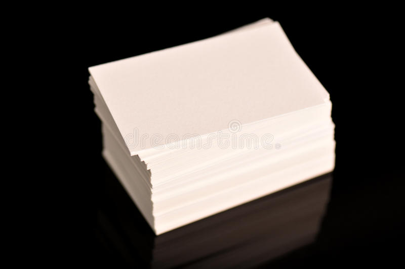 White Business Cards, flyer or banner Mockup. Blank empty template of paper cards on black background. White Business Cards, flyer or banner Mockup. Blank empty stock image