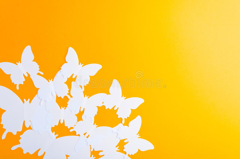White butterfly over orange paper background royalty free stock photography