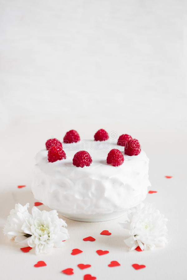 White cake with raspberries on white background stock images