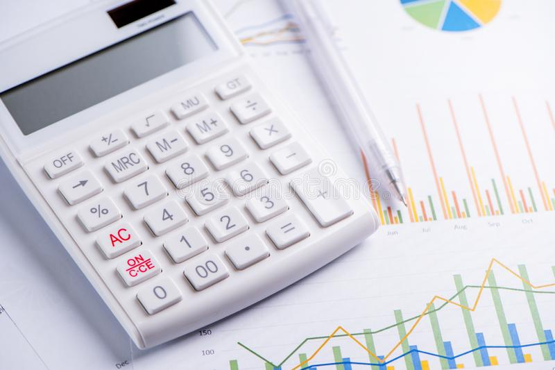 White calculator and report with chart and graph, concept of annual financial profit overview, banking and investment, close up,. Copy space, macro royalty free stock photos