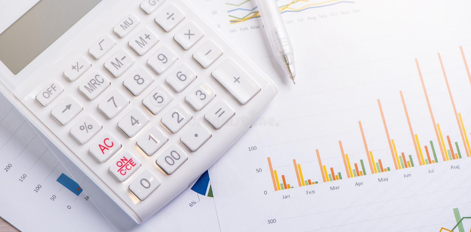 White calculator and report with chart and graph, concept of annual financial profit overview, banking and investment, close up,. Copy space, macro stock image