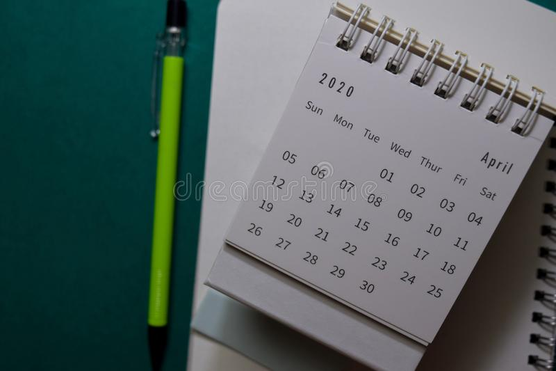 White Calendar April 2020 on office desk background stock photos