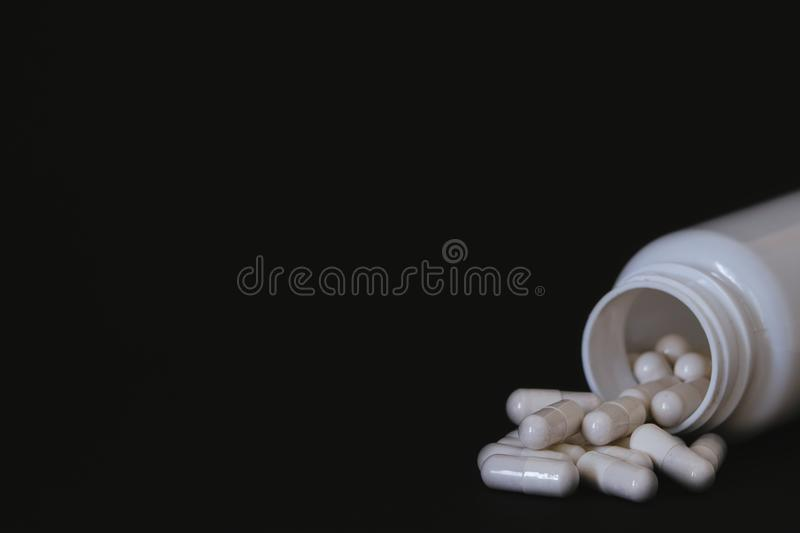 White can of vitamin pills / workout supplement stock photo