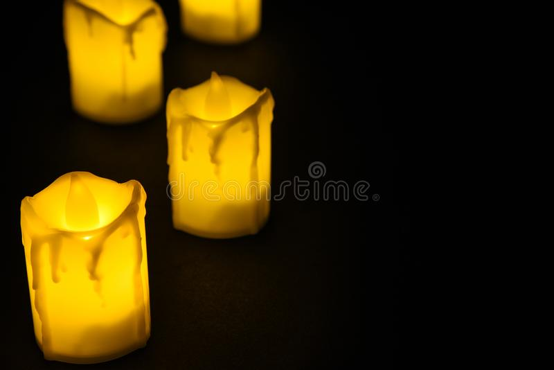 White candle on black background isolated. Set of  candle.Small candle with light yellow spots on light background. Christmas. Decor stock photos