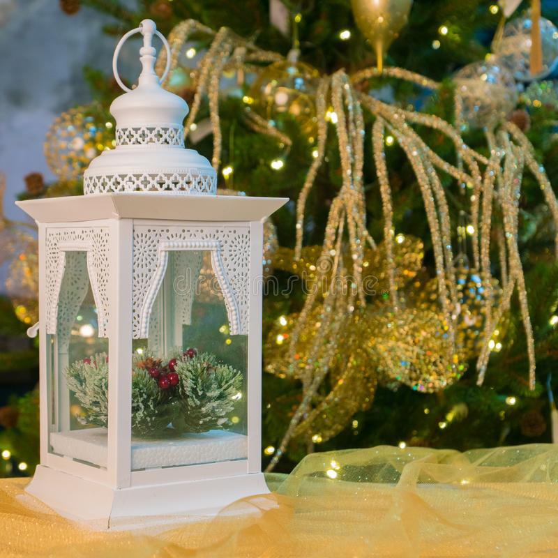 White candle lamp over christmas tree background royalty free stock photos