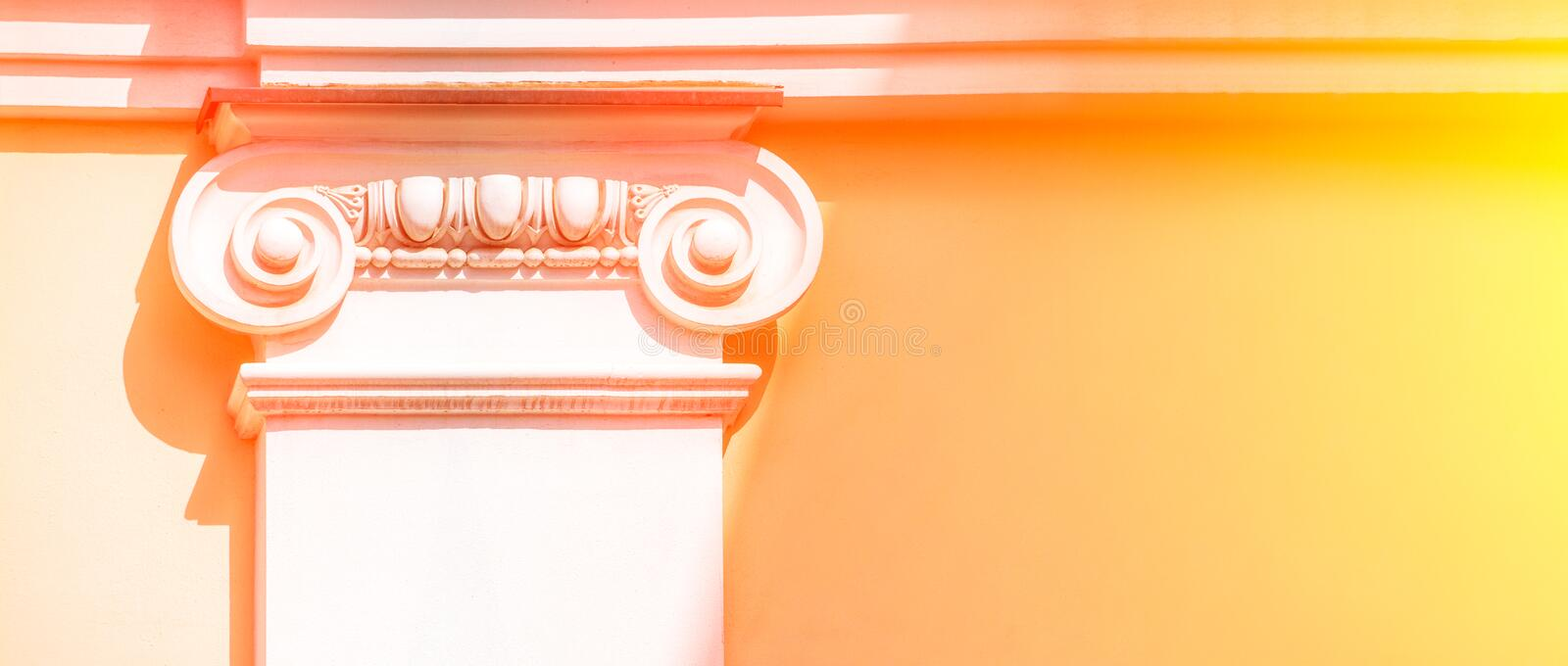 White capital at the top of the column. Beautiful architectural element. Corinthian order. The upper part of the column.  royalty free stock photo