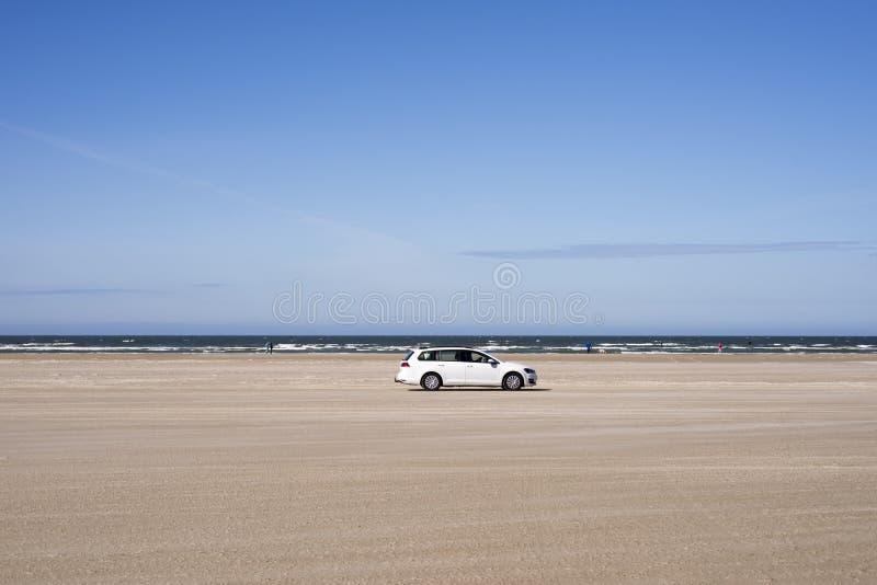 White car on beach royalty free stock photo