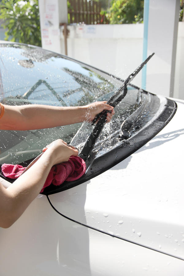 White car washing Windshield wiper with Water hose. stock images