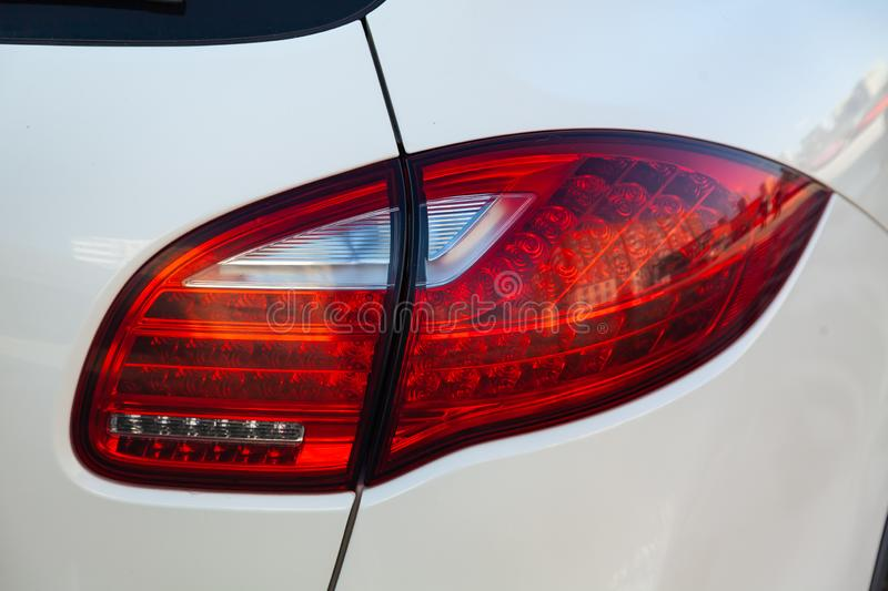 White car year rear red led taillamp view in excellent condition in a parking space among other cars at sunny day. Novosibirsk, Russia - 04.12.2019: White stock photo