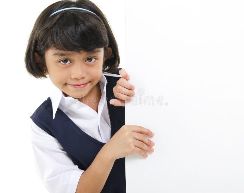 White card board. Southeast Asian schoolgirl hiding behide a white board stock photos