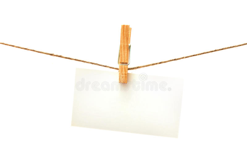 White card with clothes peg isolated royalty free stock photography
