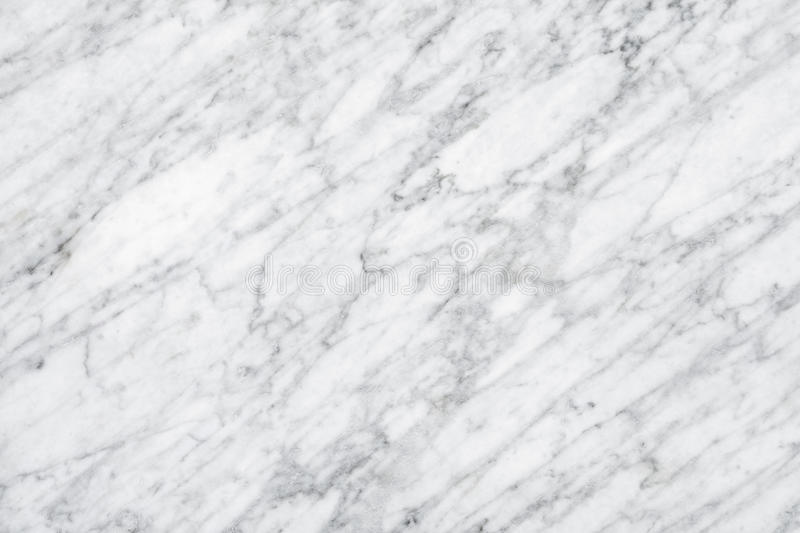 White Carrara Marble natural light surface for bathroom or kitchen countertop stock photo